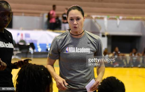 US Olympian and coach Jennifer Azzi speaks with participants as they take part in an NBA Academy Africa basketball camp at Maurice Ndiaye Stadium in...