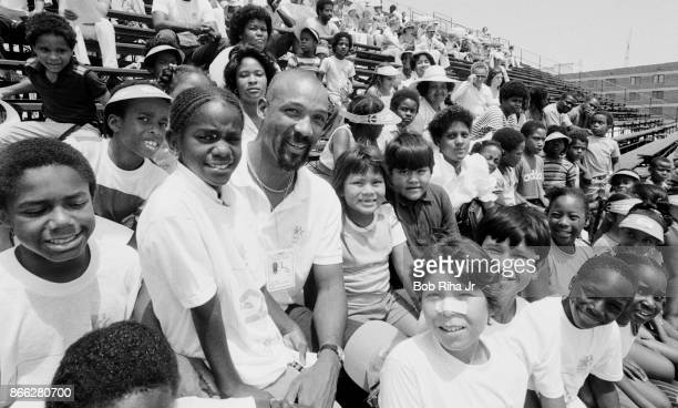 Olympian athlete John Carlos who gave a militant Black Salute during the 1968 Olympics with children from his Los Angeles area youth center August 5...