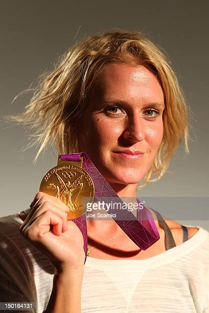 S Olympian Betsy Armstrong poses with the medal she won in the Women's Water Polo in the 2012 London Olympic Games at the USA House at the Royal...