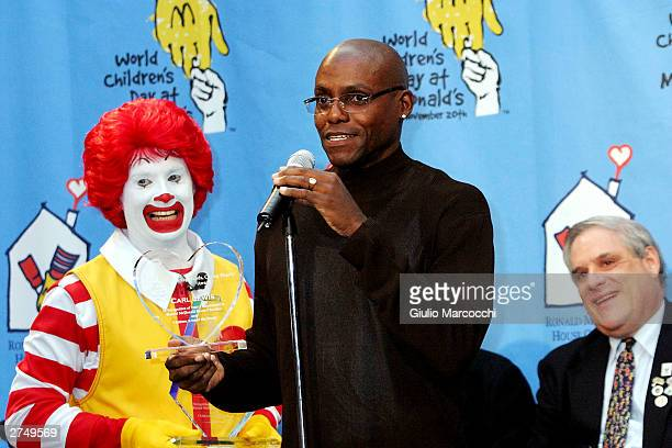 Olympian Carl Lewis attends the World Children's Day At McDonalds on November 20 2003 in Los Angeles California
