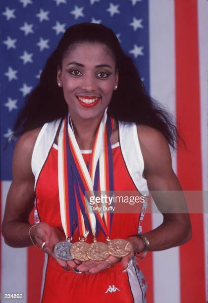 Olympian Florence GriffithJoyner during a photo shot displaying her three gold medals and one silver on April 26 1988 that she received at the 1988...