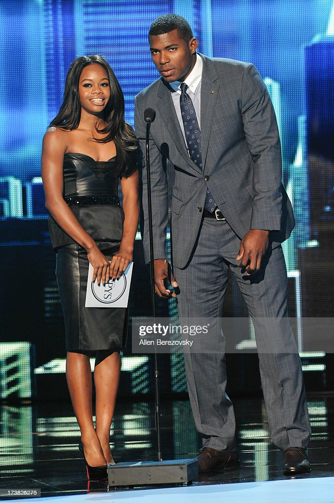 Olympian Gabrielle Douglas and MLB player Yasiel Puig onstage at the 2013 ESPY Awards at Nokia Theatre L.A. Live on July 17, 2013 in Los Angeles, California.