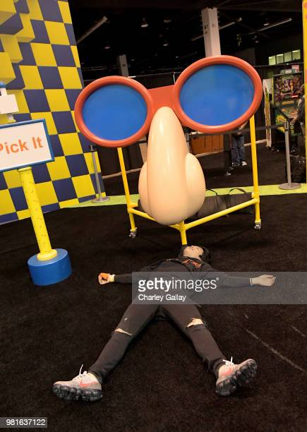 Olympian Ice Dancer Alex Shibutani experiences the Double Dare obstacle course at Nickelodeon's booth at 2018 VidCon at Anaheim Convention Center on...