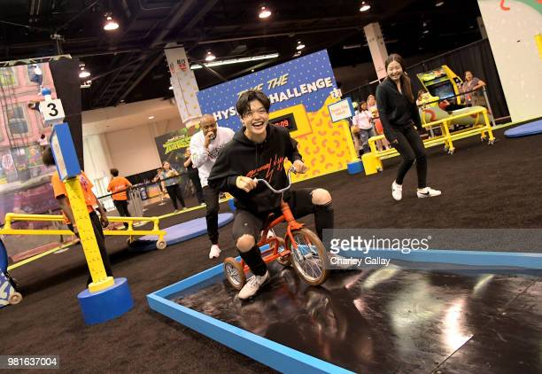 Olympian Ice Dancers Alex Shibutani and Maia Shibutani experience the Double Dare obstacle course at Nickelodeon's booth at 2018 VidCon at Anaheim...