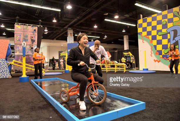 Olympian Ice Dancers Maia Shibutani and Alex Shibutani experience the Double Dare obstacle course at Nickelodeon's booth at 2018 VidCon at Anaheim...