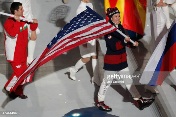 S Olympian Julie Chu carries the American Flag as part of the 2014 Sochi Winter Olympics Closing Ceremony at Fisht Olympic Stadium on February 23...