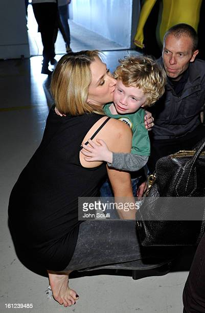 Olympian Kerri Walsh kisses her son while her husband Casey Jennings watches at the Third Annual Hall of Game Awards hosted by Cartoon Network at...