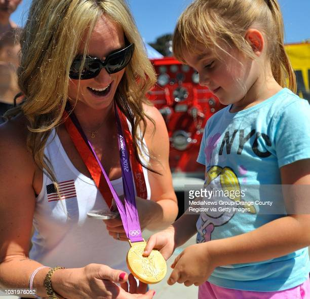 BEACH CALIF USA Olympian Lauren Wenger shows here medal to Sabrina McDermott before the start of a parade honoring Long Beach Olympians in Belmont...