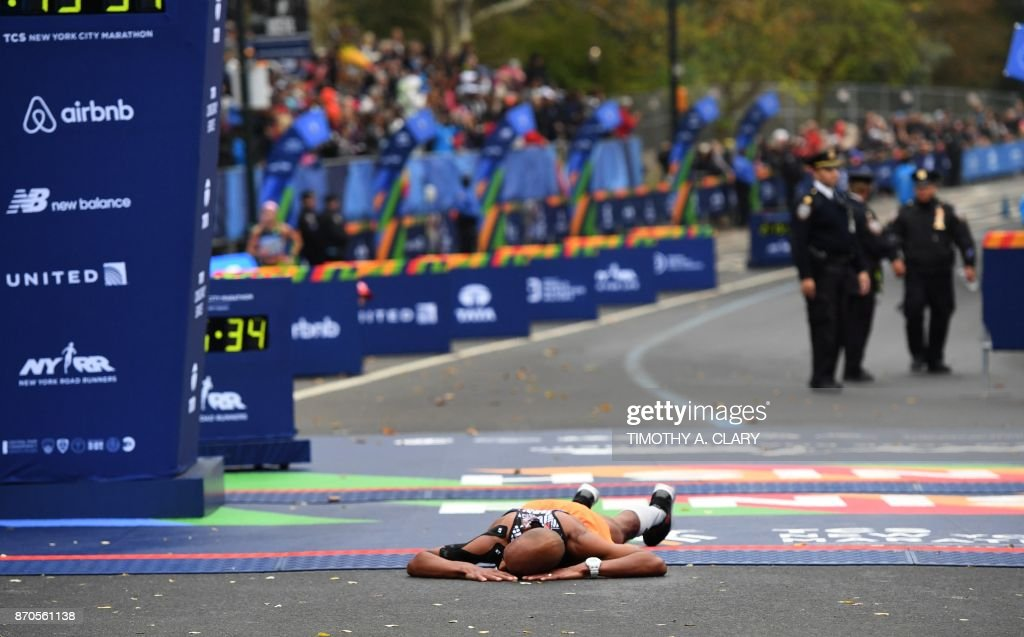 Olympian Meb Keflezighi of the US collapses at the finish line in Men's Division during the 2017 TCS New York City Marathon in New York on November 5, 2017. The american marathon great and 2009 New York winner completed his 26th and final marathon. Five days after the worst attack on New York since September 11, 2001, the city is staging a show of defiance on November 5, as 50,000runners from around the world are set to participate in the New York Marathon, under heavy security. /