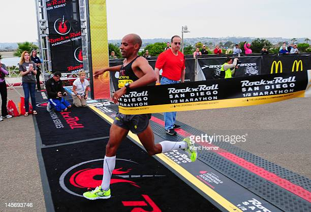 S Olympian Meb Keflezighi wins the Rock 'n' Roll Half Marathon with a time of 10311 on June 3 2012 in San Diego California