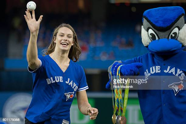 Olympian Penny Oleksiak throws the first pitch as Ace hangs onto her medals Toronto Blue Jays V Boston Red Sox in regular season action of MLB action...