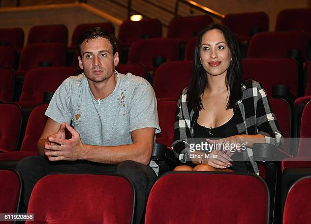 Olympian Ryan Lochte and dancer Cheryl Burke watch a private performance of O by Cirque du Soleil during a rehearsal for their Dancing with the Stars...