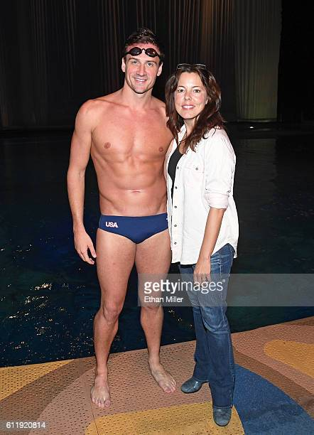 Olympian Ryan Lochte and O by Cirque du Soleil artistic director Sandi Croft pose next to the pool at the O theater during a rehearsal for Lochte and...