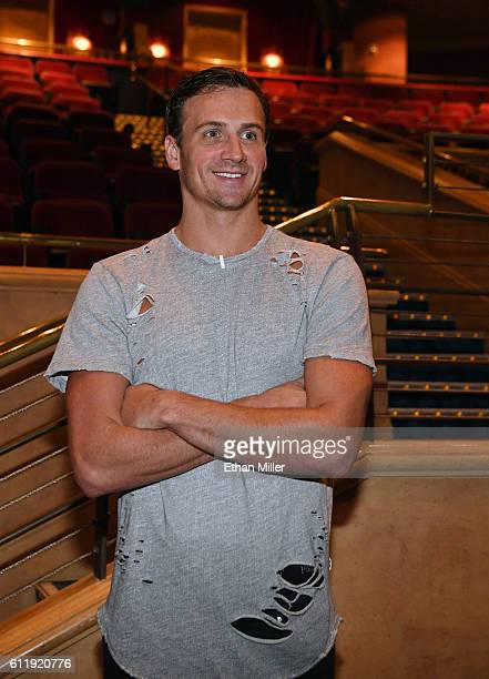 Olympian Ryan Lochte looks at the 'O' theater as he and dancer Cheryl Burke arrive at a rehearsal for their 'Dancing with the Stars' performance with...