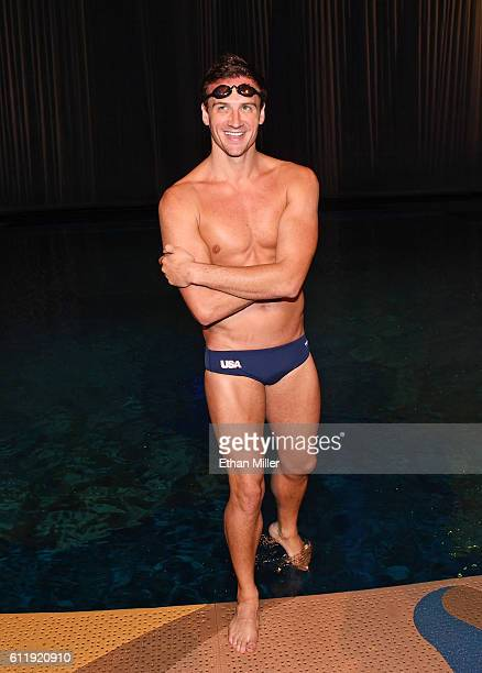 Olympian Ryan Lochte prepares to get into the pool at the O theater as he and dancer Cheryl Burke rehearse for their Dancing with the Stars...