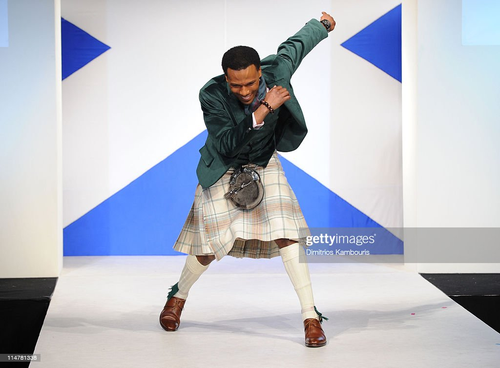Olympian Shani Davis walks the runway at the 8th annual 'Dressed To Kilt' Charity Fashion Show at M2 Ultra Lounge on April 5, 2010 in New York City.