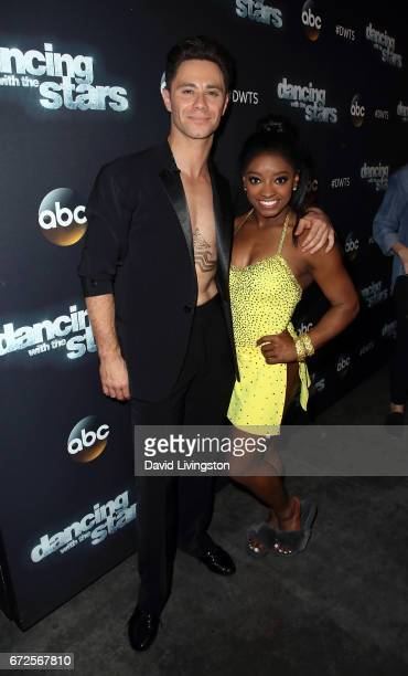 """Olympian Simone Biles and dancer Sasha Farber attend """"Dancing with the Stars"""" Season 24 at CBS Televison City on April 24, 2017 in Los Angeles,..."""