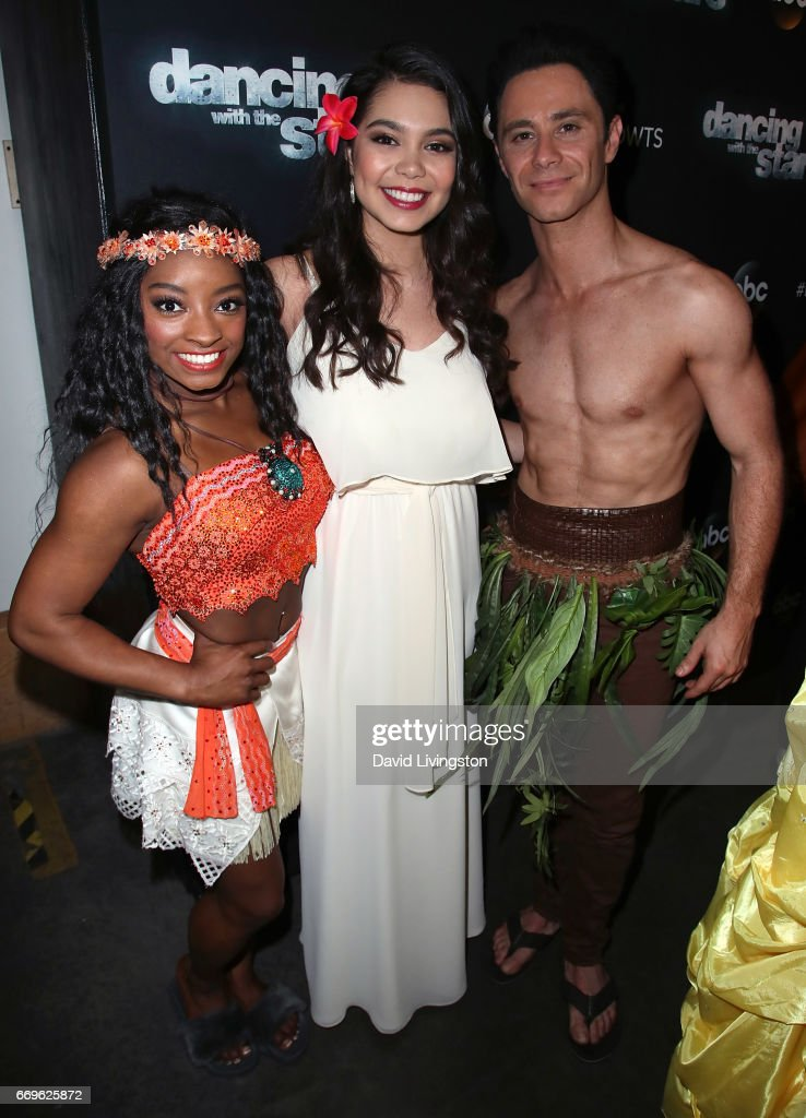 Olympian Simone Biles (L) and dancer Sasha Farber (R) poses with singer Auli'i Cravalho (C) at 'Dancing with the Stars' Season 24 at CBS Televison City on April 17, 2017 in Los Angeles, California.