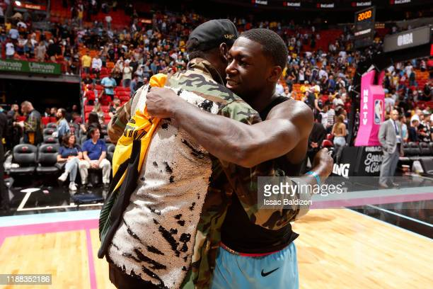 Olympian Usain Bolt and Kendrick Nunn of the Miami Heat hug after the game against the Los Angeles Lakers on December 13 2019 at American Airlines...