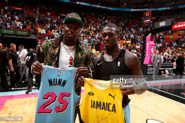 Olympian Usain Bolt and Kendrick Nunn of the Miami Heat pose for a picture after the game against the Los Angeles Lakers on December 13 2019 at...