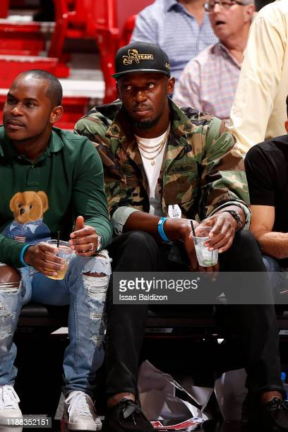 Olympian Usain Bolt attends a game between the Miami Heat and the Los Angeles Lakers on December 13 2019 at American Airlines Arena in Miami Florida...