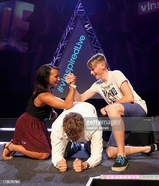 Olympian Zoe Smith arm wrestles a member of the audience on Rick Edwards back at vInspired Live a youth social change event at The Roundhouse on July...