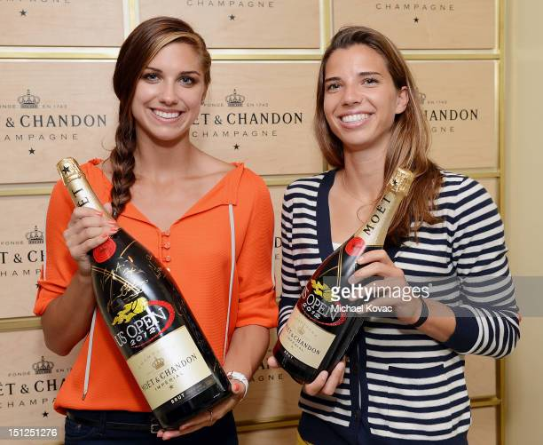Olympians Alex Morgan and Tobin Heath visit the Moet Chandon Suite at the 2012 US Open at the USTA Billie Jean King National Tennis Center on...