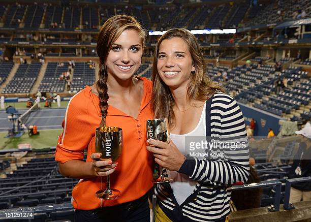 Olympians Alex Morgan and Tobin Heath visits the Moet Chandon Suite at the 2012 US Open at the USTA Billie Jean King National Tennis Center on...