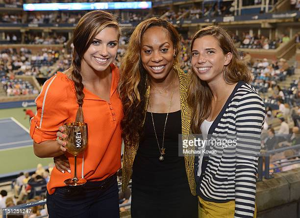 Olympians Alex Morgan Sanya RichardsRoss and Tobin Heath visits the Moet Chandon Suite at the 2012 US Open at the USTA Billie Jean King National...