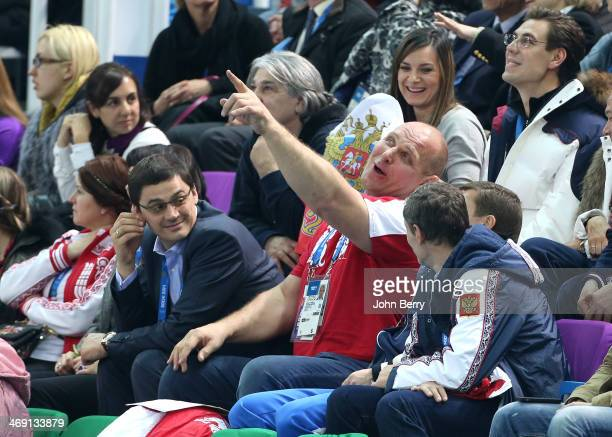 Olympians Alexander Popov Alexander Karelin and abovee them Yelena Isinbayeva of Russia attend the Figure Skating Pairs Free Program on day 5 of the...