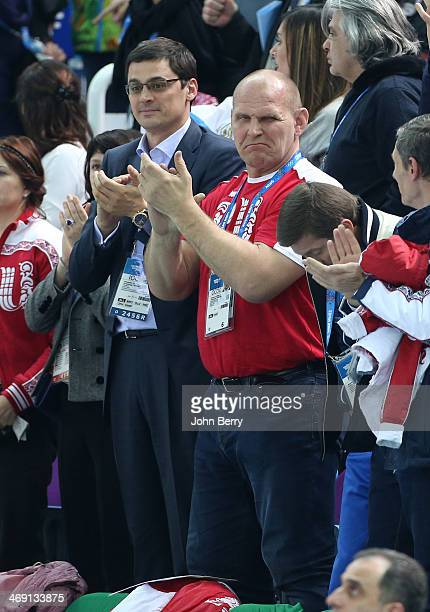 Olympians Alexander Popov and Alexander Karelin of Russia attend the Figure Skating Pairs Free Program on day 5 of the Sochi 2014 Winter Olympics at...