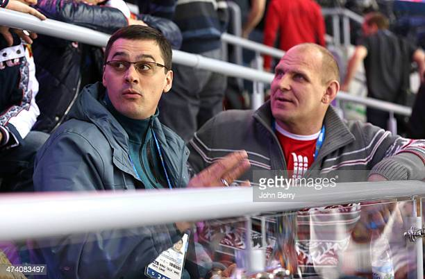 Olympians Alexander Popov and Alexander Karelin of Russia attend the Men's Ice Hockey Semifinal Playoff between Sweden and Finland on Day 14 of the...