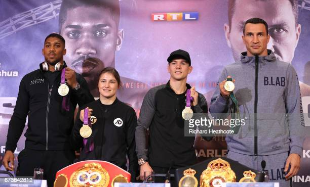 Olympians Anthony Joshua, Katie Taylor, Luke Campbell and Wladamir Klitschko pose with their medels as they part in a press conference for their...