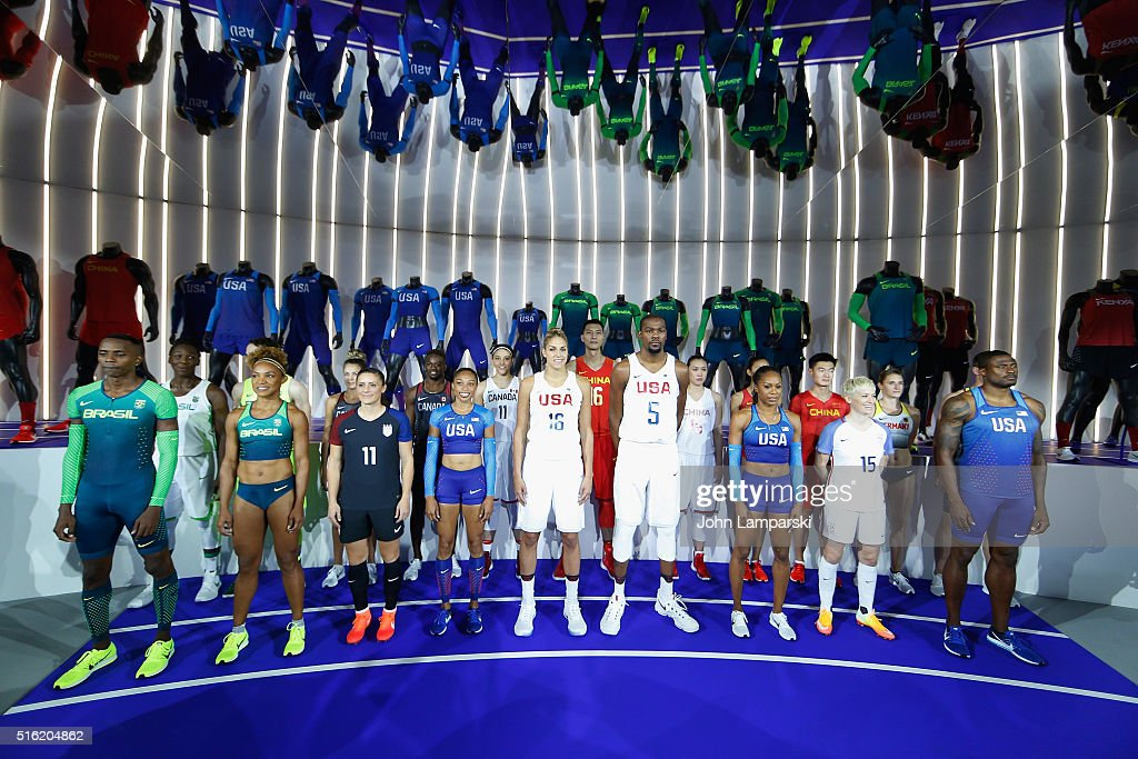 USA Olympians, Elena Delle Donne, Kevin Durant, Ali Krieger, Alyson Felix, Megan Rapione, Sanya Richards Ross( F) pose with athelites from China, Yi Jianlian, Shao Ting (R) along with athelites from Brasil, Germany and Canada during the 2016 Olympics Uniforms for USA and International Federations debut at Skylight at Moynihan Station on March 17, 2016 in New York City.