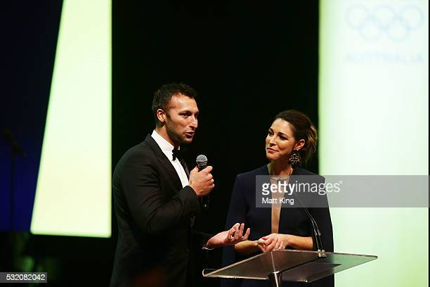 Olympians Ian Thorpe and Giaan Rooney speak on stage during the AOC Athlete Farewell Dinner at The Star on May 18 2016 in Sydney Australia