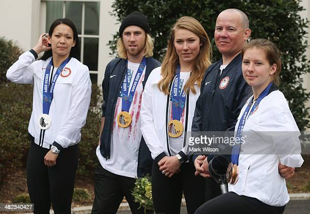 US Olympians Julie Chu Sage Kostenberg Mikaela Shiffrin and US Paralympians Jon Lujan and Stephanie Jallen stand together while speaking to the media...