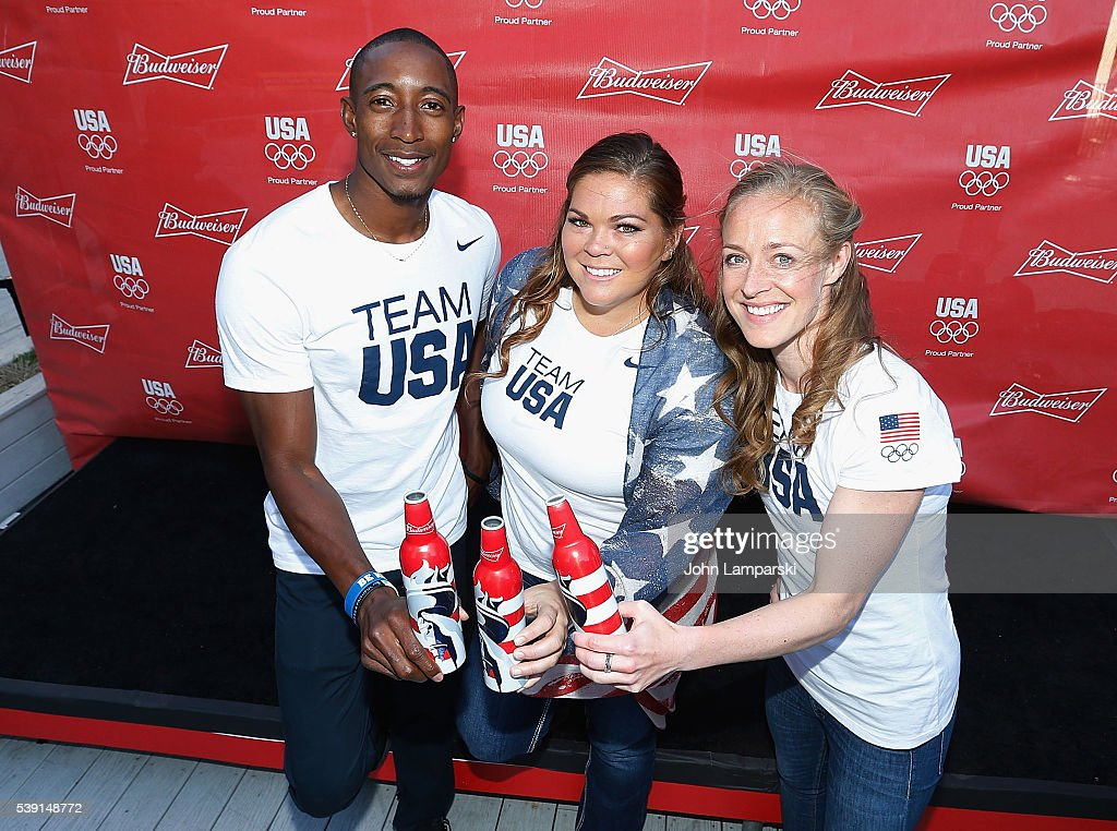 Olympians Perry Baker, Amanda Bingson and Becky Sauerbrunn attend A Toast To Team Budweiser mural unveiling at Bar Local on June 9, 2016 in New York City.