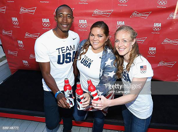 Olympians Perry Baker Amanda Bingson and Becky Sauerbrunn attend A Toast To Team Budweiser mural unveiling at Bar Local on June 9 2016 in New York...