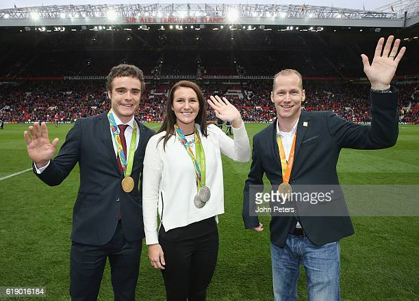 Olympians Steven Burke and Jazz Carlin and Paralympian Sasha Kindred pose at halftime during the Premier League match between Manchester United and...