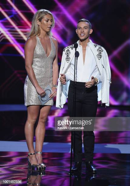 Olympic alpine skier Mikaela Shiffrin and Olympic figure skater Adam Rippon speak onstage at The 2018 ESPYS at Microsoft Theater on July 18, 2018 in...