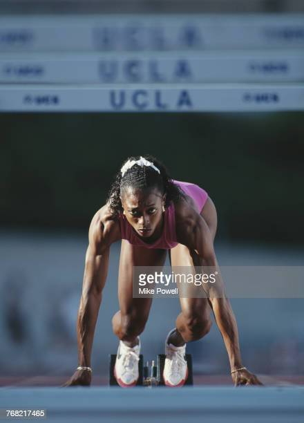 Olympic and Athletics World Championship gold medallist Gail Devers of the United States concentrates as she stands in the starting blocks during a...