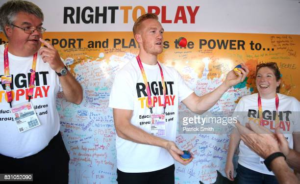 Olympic and World Champion Long Jumper Greg Rutherford juggles as he attends a Right To Play event during day ten of the 16th IAAF World Athletics...
