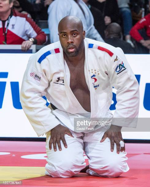 Olympic and World champion, Teddy Riner of France rises from the mat after holding Stephan Hegyi of Austria for an ippon to win their second round...