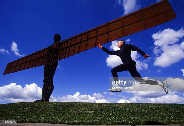 Olympic and World Triple Jump Champion and World Record holder Jonathan Edwards takes a jump at the Angel of the North Sculpture in Gateshead Great...