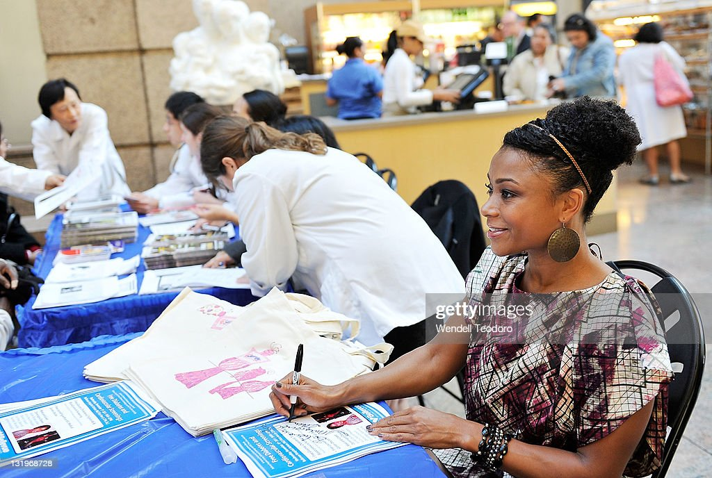 Olympic Athlete Dominique Dawes signs autographs during the free diabetes testing at the Bellevue Hospital Center Atrium on November 9, 2011 in New York City.