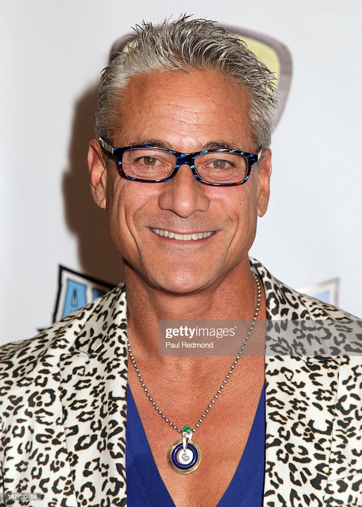 Olympic athlete Greg Louganis arrives at the All Sports Film Festival closing ceremony honoring Bruce Jenner at El Portal Theatre on November 11, 2013 in North Hollywood, California.