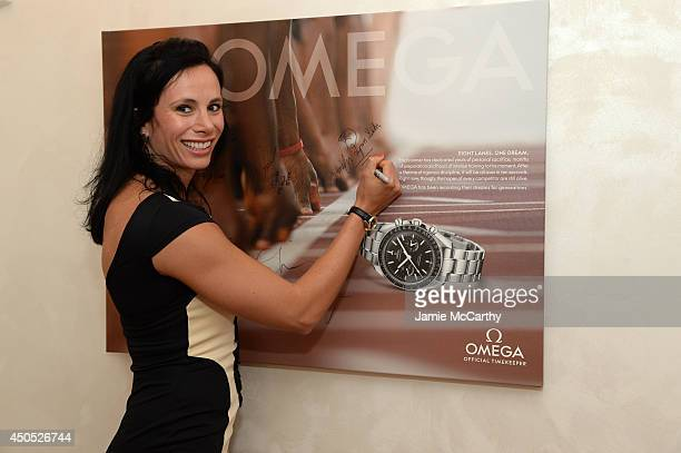 Olympic athlete Jenn Suhr signs her autograph at the adidas Grand Prix celebration hosted by OMEGA at the OMEGA Fifth Avenue Boutique on June 12 2014...