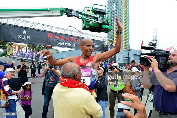 Olympic athlete Meb Keflezighi celebrates at the finish line after taking 2nd place in the Suja Rock 'n' Roll San Diego Marathon 1/2 Marathon on May...