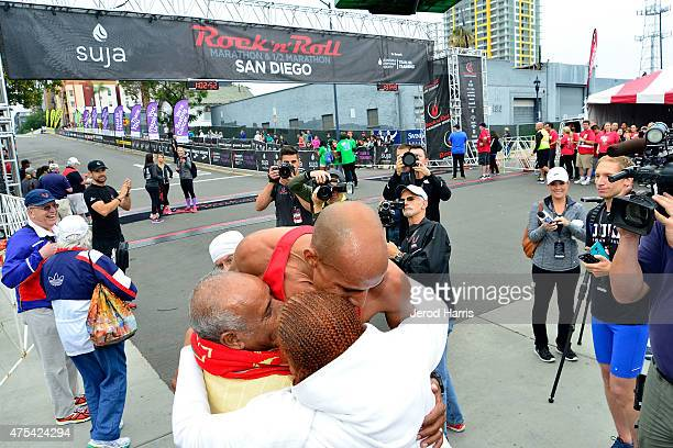Olympic athlete Meb Keflezighi shares a moment with his family after taking 2nd place in the Suja Rock 'n' Roll San Diego Marathon 1/2 Marathon on...