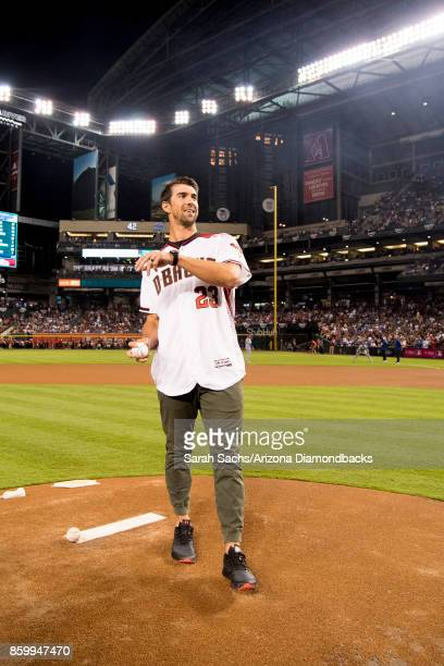 Olympic athlete Michael Phelps throws out the ceremonial first pitch prior to game three of the National League Division Series between the Arizona...